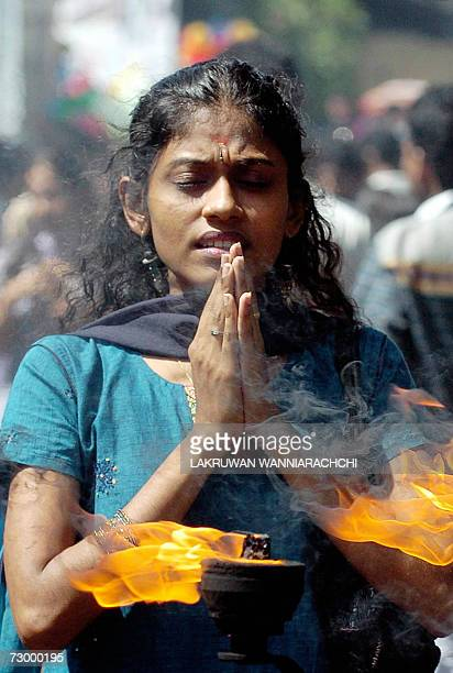 A Sri Lankan Hindu woman offers prayers outside a Hindu Temple in Colombo 15 January 2007 during events marking the Pongal festival Pongal is a key...