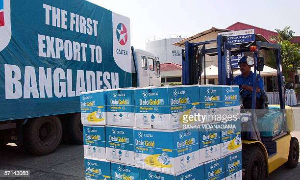 An employee of Caltex Lanka Lubricants loads the firm's first lube shipment of 6million litres to Bangladesh Caltex Lanka Lubricants a unit of...