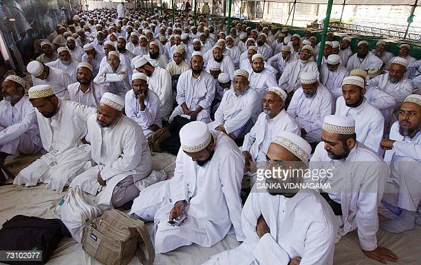 Members of the Bohra community pray at a makeshift extension of their mosque covering a main highway in Sri Lanka's capital Colombo 24 January 2007...