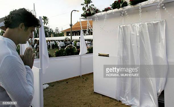 Raghavan Kadirgamar son of slain Sri Lankan Foreign Minister Lakshman Kadirgamar prays in front of his father's funeral pyre after performing the...