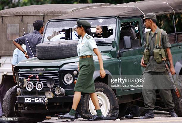 Sri Lanka army personnels conduct investigations at the site of a suicide bomb attack on a defence ministry convoy in Colombo 01 December 2006 Sri...