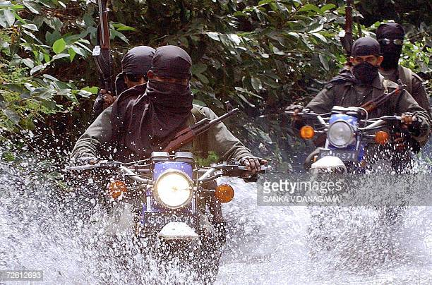 Sri Lanka army special motorcycle unit soldiers conduct a patrol through a flooded street in the capital Colombo 21 November 2006 Heavy monsoon rains...