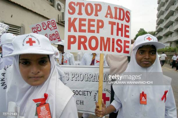 Sri Lankan children take part in a walk to marking world AIDS day in Colombo 01 December 2006 The event was marred by a suicide bomb attack against...