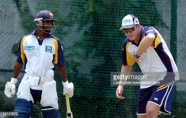 Sri Lankan cricket coach Tom Moody gives batting tips to cricketer Chamara Silva during a practice session at the Nondescript Cricket Club in Colombo...