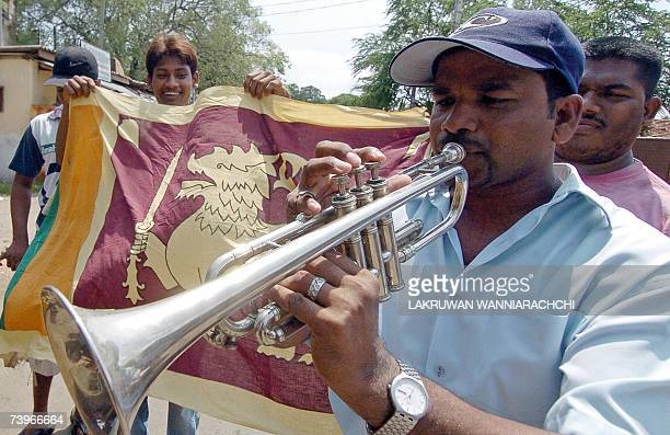 Sri Lankan cricket fans celebrate their team's win in a World Cup 2007 semifinal match against New Zealand in the streets of Colombo 25 April 2007...