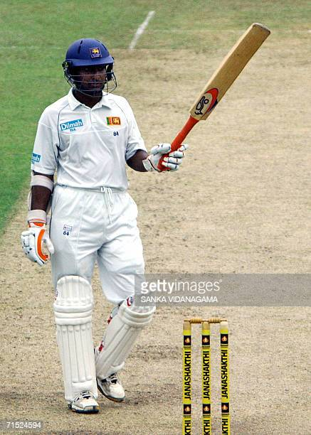 Sri Lankan cricketer Kumar Sangakkara celebrates his half century during the first day of the first Test match between Sri Lanka and South Affrica at...