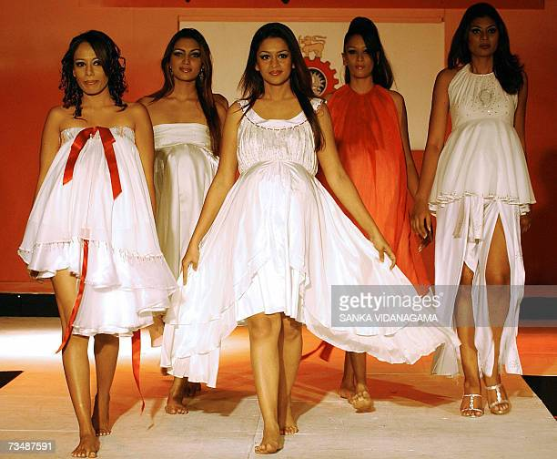 Sri Lankan models present maternity wear creations by graduating students of the University of Moratuwa during a runway fashion show in Colombo 04...