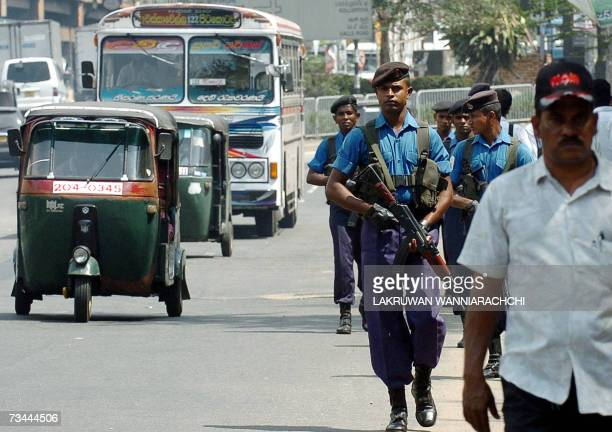 Sri Lankan navy sailors patrol the streets of Colombo 28 February 2007 Sri Lanka escalated sea and land attacks against Tamil Tigers and killed at...