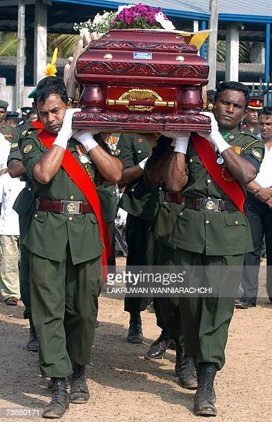 The Sri Lankan flag is draped over the coffin of Army Colonel Jayantha Suraweera as the funeral procession makes its way to the cemetery in the...