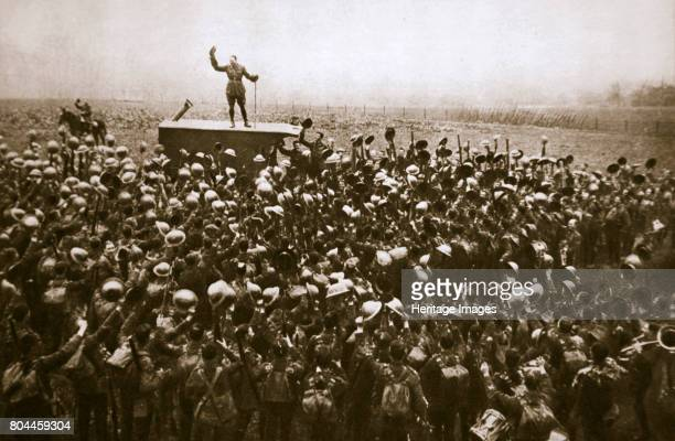 Colonel and men of the 9th East Surrey Regiment cheering the King France 12 November 1918 Near Bavay the day after the end of the First World War...