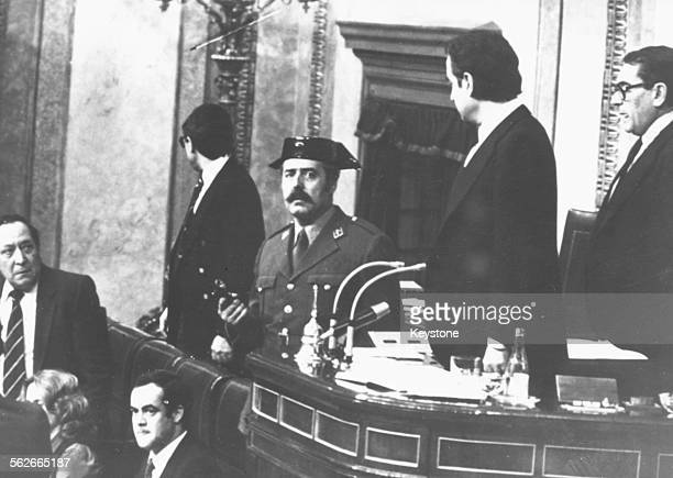 Colonel Antonio Tejero brandishing a gun as he attempts to take over Spanish parliament in a coup with the Guardia Civil, February 1981.