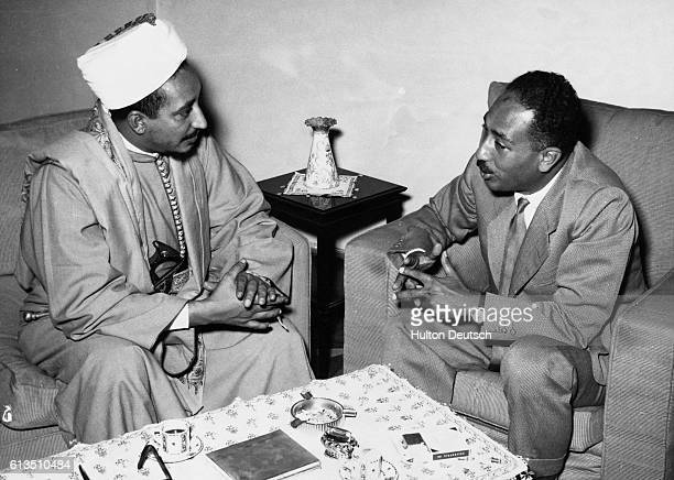 Colonel Anwar El Sadat the Egyptian politician and SecretaryGeneral of the Islamic Congress with Amir Badr Seif El Islam son of the Imam of Yemen...