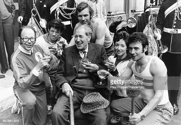 Colonel Arnold Jackson British Army officer and Olympic athlete shares a celebratory drink with fellow gold medal winners Chris Brasher Don Thompson...