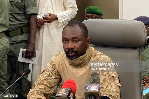 Colonel Assimi Goita speaks to the press at the Malian Ministry of Defence in Bamako Mali on August 19 2020 after confirming his position as the...