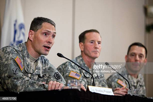 Colonel Bradley Poppen PhD Major General Joseph P DiSalvo and Colonel Ronald N Wool deliver a press conference at the Fort Sam Houston Golf Course...