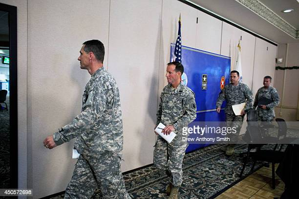Colonel Bradley Poppen PhD Major General Joseph P DiSalvo Colonel Ronald N Wool and PR Director Hans Bush exit a press conference at the Fort Sam...