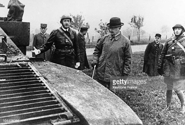 Colonel Charles DE GAULLE presenting combat tanks which are lined up along the Wingen road to French president Albert LEBRUN near Sarreinsberg in...