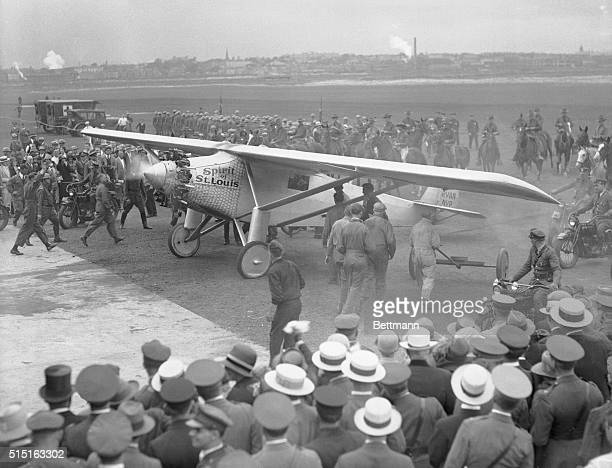 Colonel Charles Lindbergh and his plane Spirit of St. Louis arriving at the Boston Airport, Boston, Mass., during the first leg of Lindy as tour...