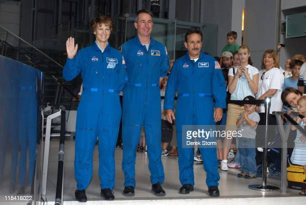 Colonel Eileen Collins Stephen Robinson and Charles Camarda of Space Shuttle Discovery speaks during a welcome home event at the Museum of Natural...