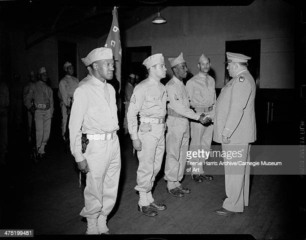 Colonel Francis Fendell of Pennsylvania State Guard shaking hands with man surrounded by Emery Dukes John V Smith and James Johnson for State Guard...