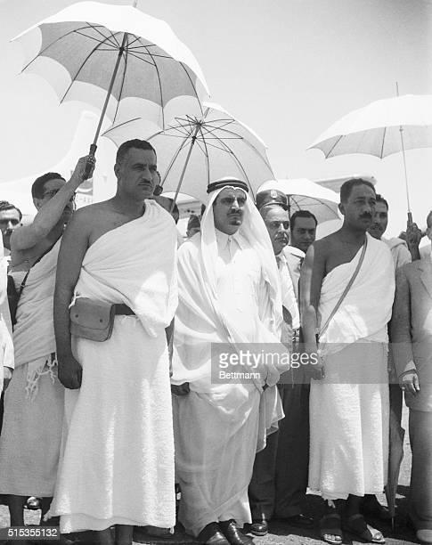 Colonel Gamal Abdel Nasser Prime Minister of Egypt is sheltered by an umbrella as he arrives in Mecca for a visit with Saudi Arabian leader Ibn Saud...