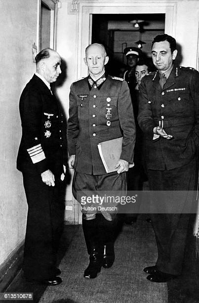 Colonel General Gustaf Jodl a Nazi chief of staff and signator of the German surrender together with his aide Gen Adm Hans George von Friedeburg as...