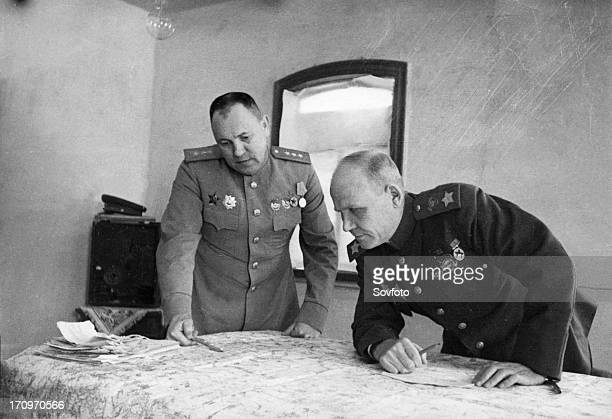 Colonel general m zakharov chief of staff of the second ukrainian front and marshall i konev laying plans for the encirclement of the germans prior...