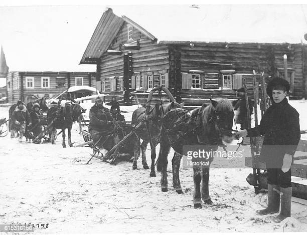 Colonel George E Stewart commanding American forces in Northern Russia passing by convoy through village of Chamova on his return from Dwina River...