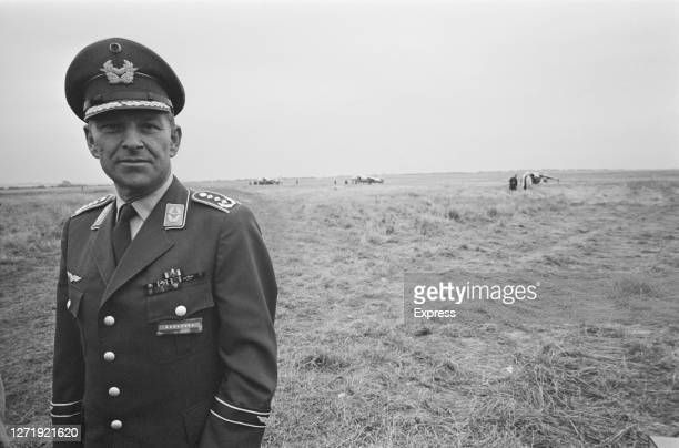 Colonel Gerhard Barkhorn heads the German contingent of the Kestrel Tripartite Evaluation Squadron during a demonstration to the press at RAF West...
