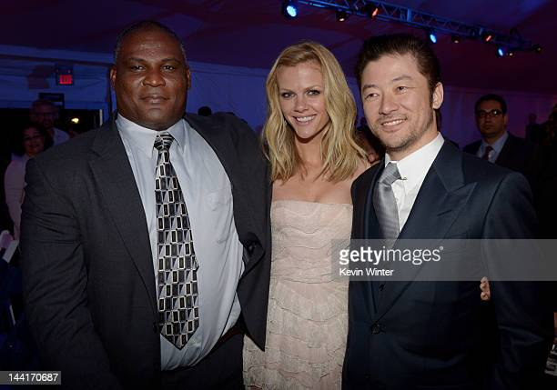 Colonel Gregory D Gadson actors Brooklyn Decker and Tadanobu Asano pose at the after party for the premiere of Universal Pictures' Battleship at LA...