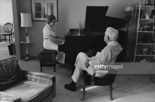 Colonel Harland David Sanders and his wife Claudia at home Claudia plays the piano Kentucky September 1974