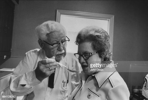 Colonel Harland David Sanders and his wife Claudia in their kitchen Hartland gives Claudia a taste of the cooking Colonel Sanders founded restaurant...