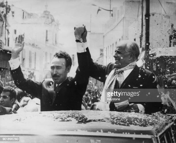 Colonel Houari Boumédiène the Algerian leader drives through the streets of Tunis with Habib Bourguiba the President of Tunisia during a sevenday...