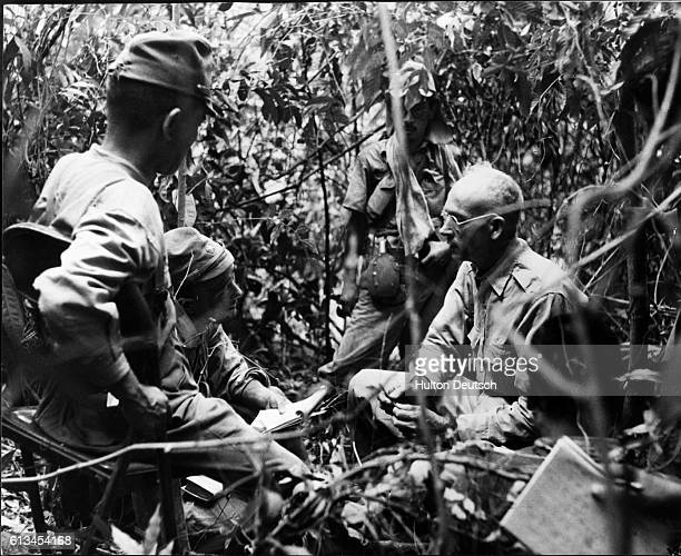 Colonel Hugh Straughn an American guerrilla leader fighting against Japanese forces on the island of Luzon in the Philippines is questioned after his...