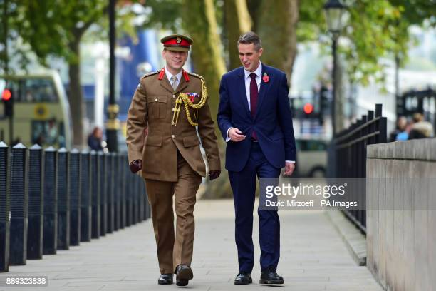 Colonel John Clark Military Assistant to the Prime Minister and Gavin Williamson outside the Ministry of Defence in London after he was named as the...