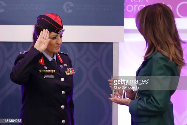 Colonel Khalida Khalaf Hanna alTwal of Jordan salutes as US First lady Melania Trump presents her with the International Women of Courage Award...