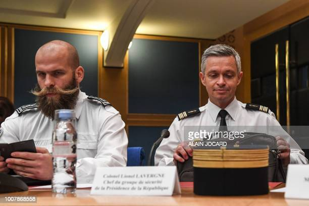 Colonel Lionel Lavergne head of French Presidency Security Group and Chief Superintendent and Deputy Chief of the Julien Perroudon sit before the...