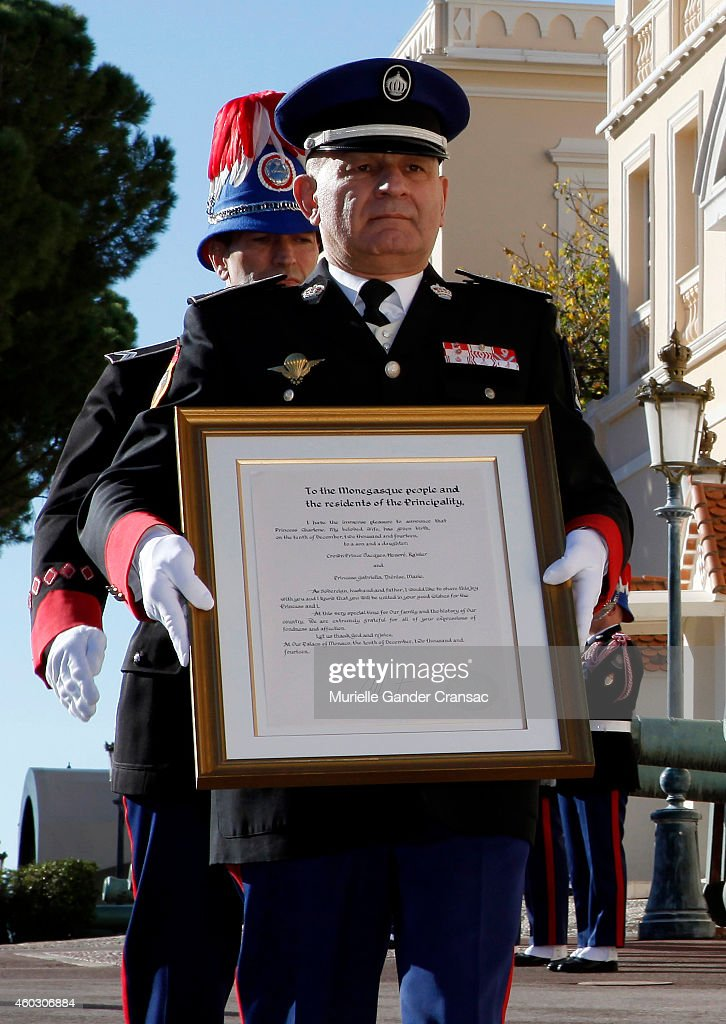 Colonel Luc Frigan carries the official announcement of the birth of the royal twins Prince Jacques and Princess Gabriella to the outside wall of the Monaco Palace on December 11, 2014 in Monaco, Monaco.