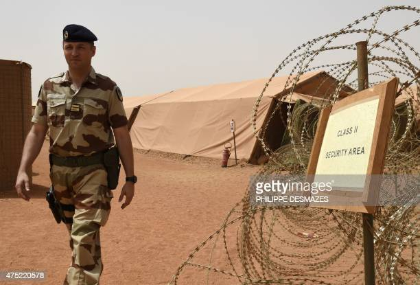 Colonel Luc Laine commander of the French army base walks past during the Barkhane operation on May 29 in Gao northern Mali Based in Mali's...