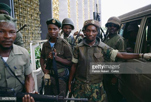 Colonel Michael Tilly leader of the Death Squad a faction of President Samuel Doe's Armed Forces of Liberia stands among his troops in Monrovia...