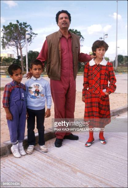 Colonel Muammar Gaddafi with daughter Aicha and sons near Bab Azizia palace destroyed in a US air raid and left in ruins in November 1986 in Tripoli...