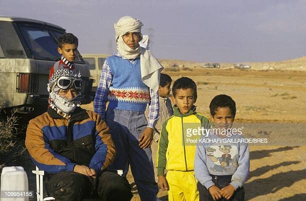 Colonel Muammar Gaddafi with his children from left Hannibal Saadi Khamis and Seif al Islam near Bab Azizia palace destroyed in a US air raid and...