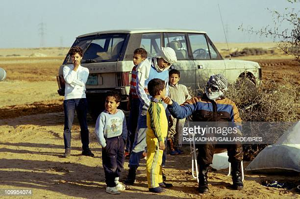 Colonel Muammar Gaddafi with his family near Bab Azizia palace destroyed in a US air raid and left in ruins November 1986