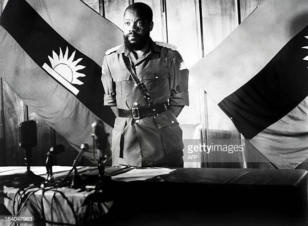 Colonel Odumegwu Emeka Ojukwu the leader of the breakaway Republic of Biafra delivers a press conference on August 16 1967 in front of a Biafra flag...