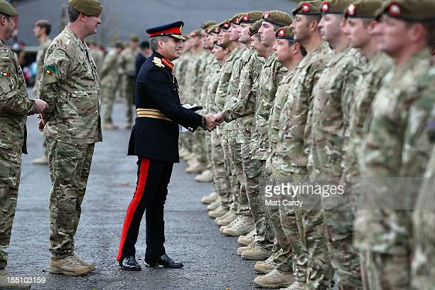 Colonel of the Regiment Major General PD Jones CBE gives soldiers from 1st Battalion The Royal Anglian Regiment their Afghanistan Operational Service...