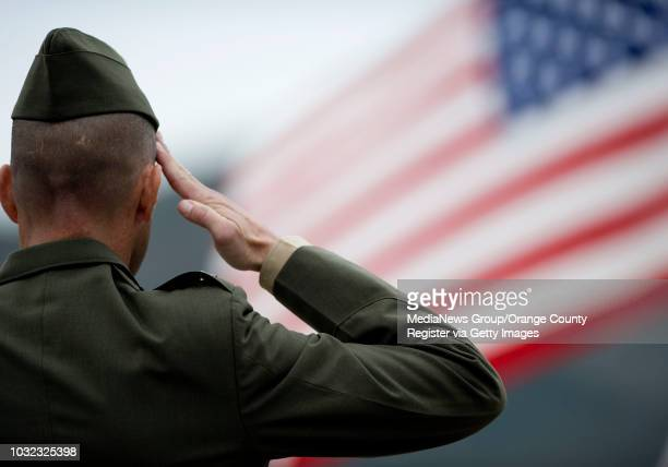 Colonel Peter B Baumgarten Commanding Officer of the 1st Marine Regiment salutes the flag during a ceremony celebrating the Camp Pendletonbased...