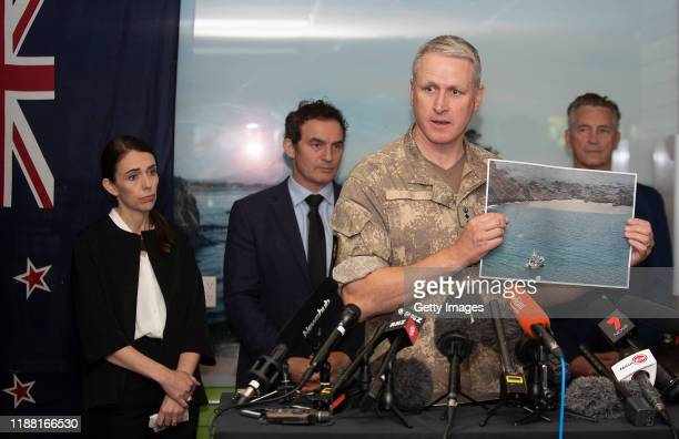 Colonel Rian McKristry explains a photo taken while bodies were being removed from the Island at a press conference at the Whakatane District Council...