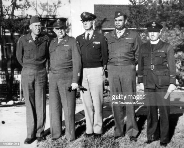Colonel Roy H Parker Colonel M S Halloran Lt Colonel W T Brundick Captain Rufus A Cooper and Chaplain C Vaundry all members of the Eighth Army...