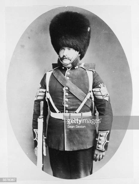 Colonel Sergeant Walls of the 1st Battalion Grenadier Guards wearing the grenadier's bearskin cap Gold toned albumen print