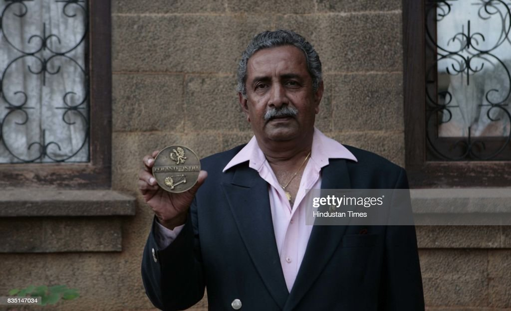 Colonel Vijaysinh Gaikwad shows the Polish government medallion he received for the help his family extended to the refugees.